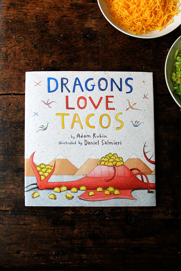 Dragons Love Tacos book on the table.