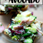 An overhead shot of a smoked trout and avocado salad on toasty bread.