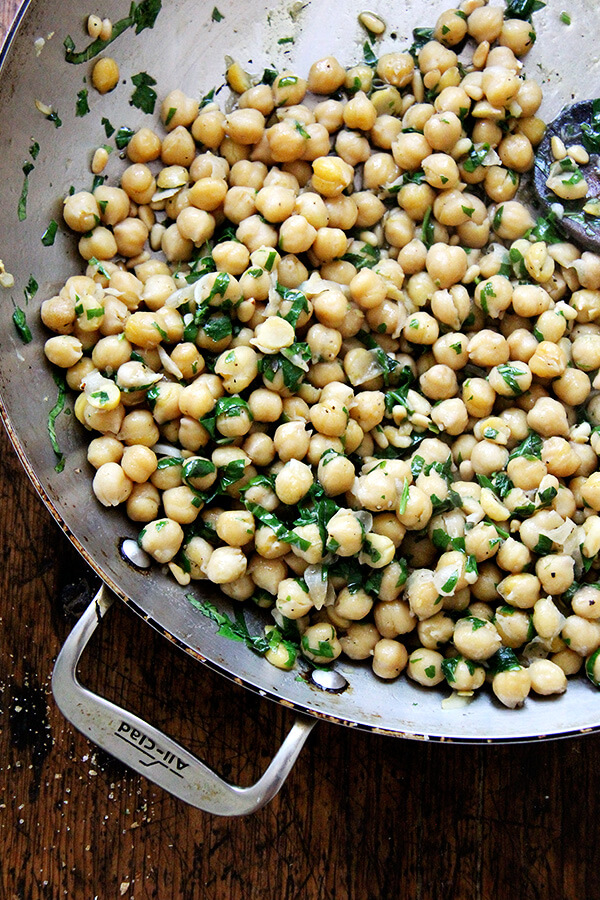 chickpeas and basil in pan