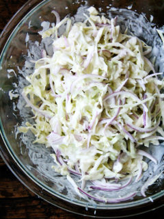Cabbage arrives as early as those tender greens and continues through the fall and early winter. Make this cabbage slaw spicy with a few dashes of Tabasco, add herbs, add other vegetables, or just keep it simple. // alexandracooks.com