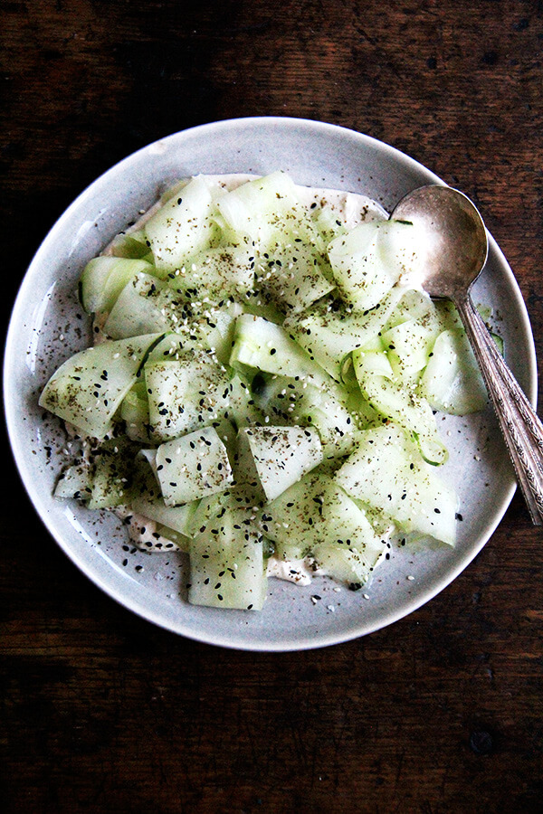 This cucumber salad with tahini-yogurt sauce essentially is a no-cook meal, a refreshing salad to make good use of those cool summer cucs, which might just be arriving in droves. I serve it along side broiled slices of ciabatta. Yum. // alexandracooks.com