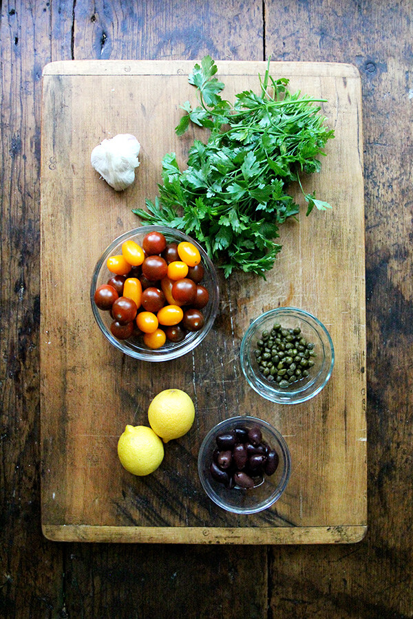 Sauce Nicoise ingredients on a board.