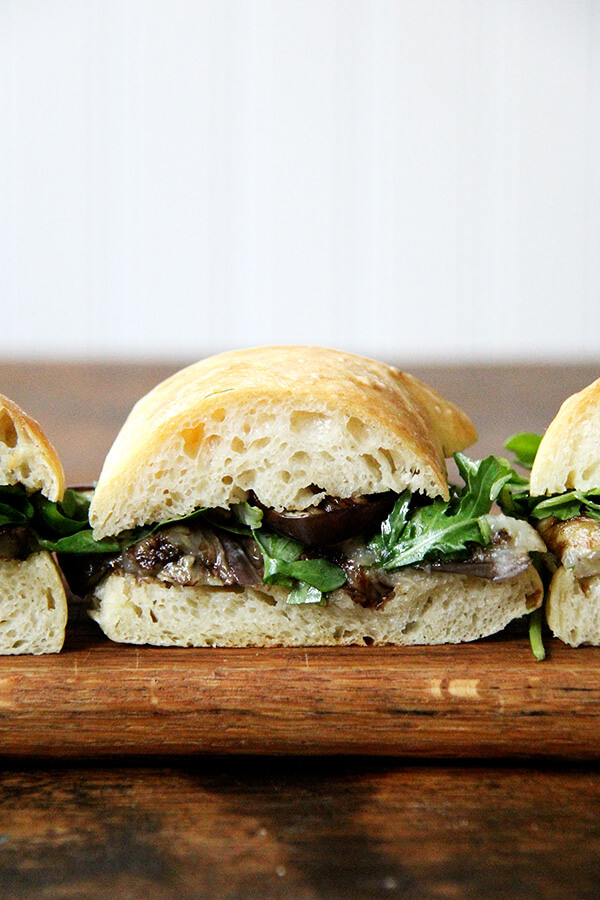 These sandwich rolls are a simple variation of the peasant bread recipe. If you take 5 minutes to mix the dough together this evening, you will be rewarded with the makings of a super-simple Friday night dinner, delicious vessels fit for flanking whatever your heart desires, but may I suggest balsamic-roasted eggplant and arugula? It's so good. // alexandracooks.com