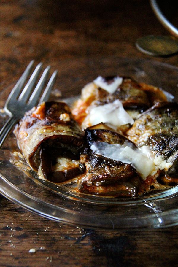 Eggplant involtini — tender slices of eggplant rolled into ricotta-stuffed parcels baked with homemade tomato sauce — never tastes better than this time of year, when the eggplant and tomatoes begin arriving in full force. The adorable eggplant bundles can be assembled ahead of time, nestled in their tomato sauce-slicked dish, and stashed in the fridge until needed. // alexandracooks.com