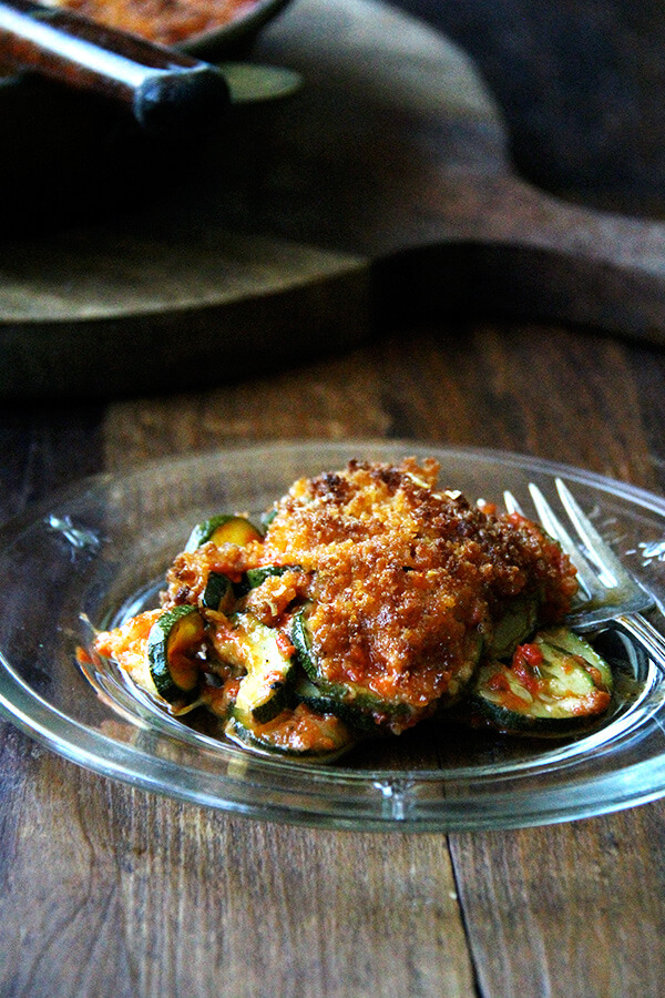 If you're looking for zucchini recipes to help you cull your zucchini crops down, this recipe for zucchini parmesan will fit the bill! Roasting zucchini rounds for 10 minutes, then layering them with homemade sauce and parmesan cheese and finishing it off with a breadcrumb topping. Simple but delicious! // alexandracooks.com