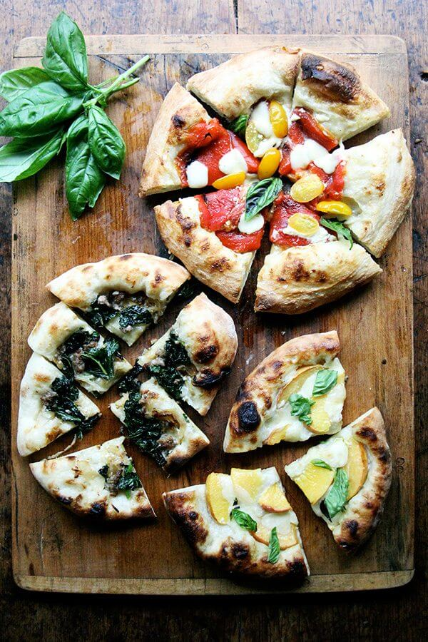 Here are recipes for three summer pizzas — peach and basil, broccoli rabe and sausage, and roasted red pepper and tomato — plus a few pizza-making tips. And even in the summer heat, each colorful crème fraîche-slicked pie makes every second spent in my sultry kitchen well worth it. // alexandracooks.com