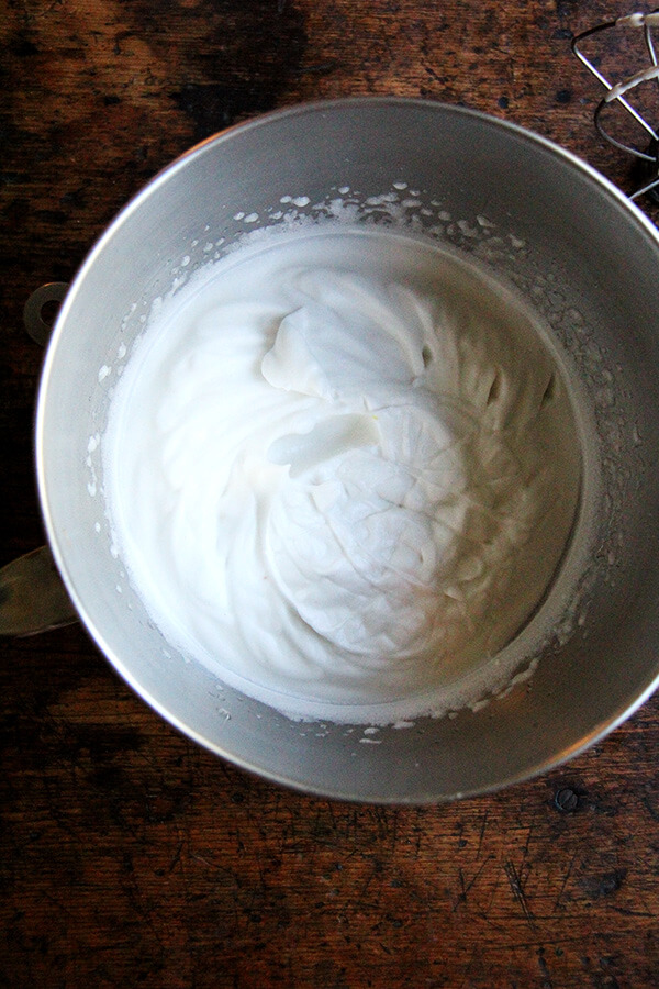 A stand mixer bowl filled with whipped homemade aquafaba.