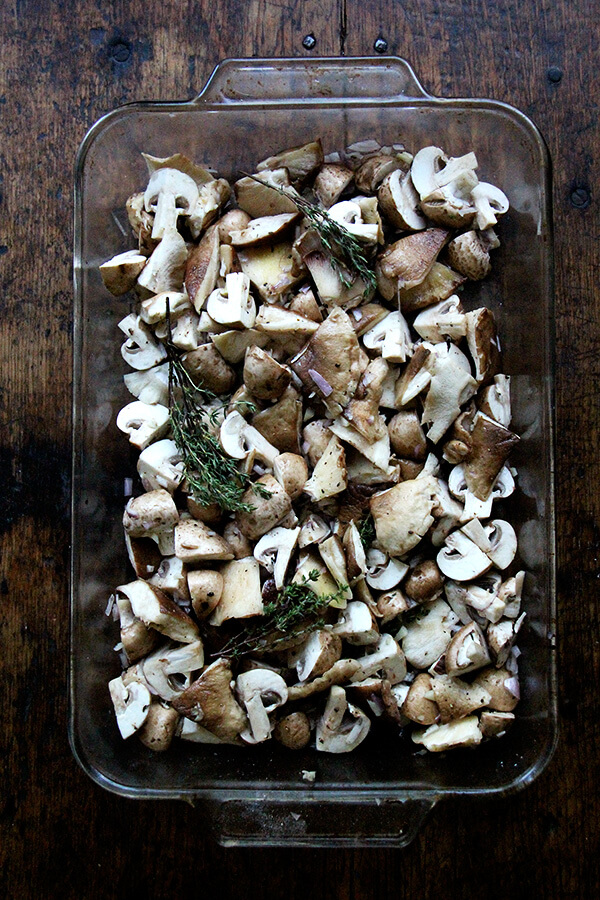 A 9x13-inch pan filled with mushrooms and thyme.