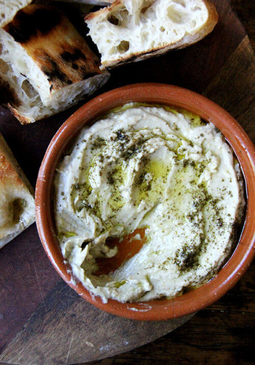 This smoky eggplant dip calls for charring whole eggplant on a grill or over an open flame until the skin is blackened. The rest is easy: pulse the eggplant flesh in a food processor with tahini, Greek yogurt, salt, and fresh lemon, and before serving, drizzle with olive oil and sprinkle with za'atar. Yum. // alexandracooks.com