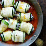 A pan of unbaked zucchini involtini.