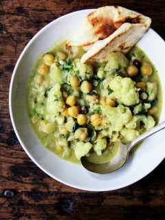 A pot of curried chickpeas with cauliflower and coconut milk.