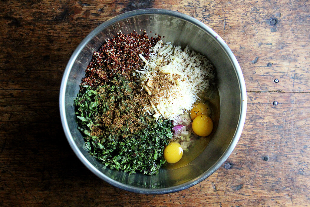 ingredients to make crispy quinoa cakes in a bowl