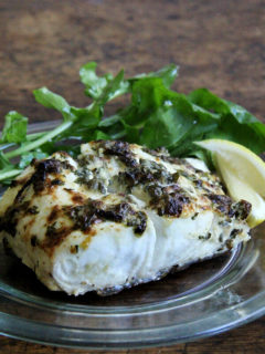 Here, a simple mixture of mayonnaise, mustard, capers, lemon zest and parsley has been spread atop the halibut fillets before cooking. It browns beautifully under the broiler, creating a thin, tasty crust. The fish needs nothing more than a squeeze of lemon upon serving. // alexandracooks.com