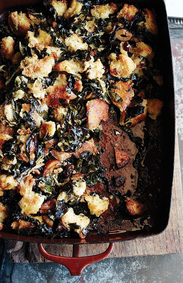 Sometimes all you want is a no-frills stuffing: bread tossed with seasoning, mixed with copious amounts of butter, onions, and celery. But sometimes you want a stuffing studded with dried cranberries and chestnuts, laced with sweet onions (also sautéed in copious amounts of butter), strewn with kale that crisps up like chips as irresistible as the crusty cubes it surrounds. You can have both. // alexandracooks.com