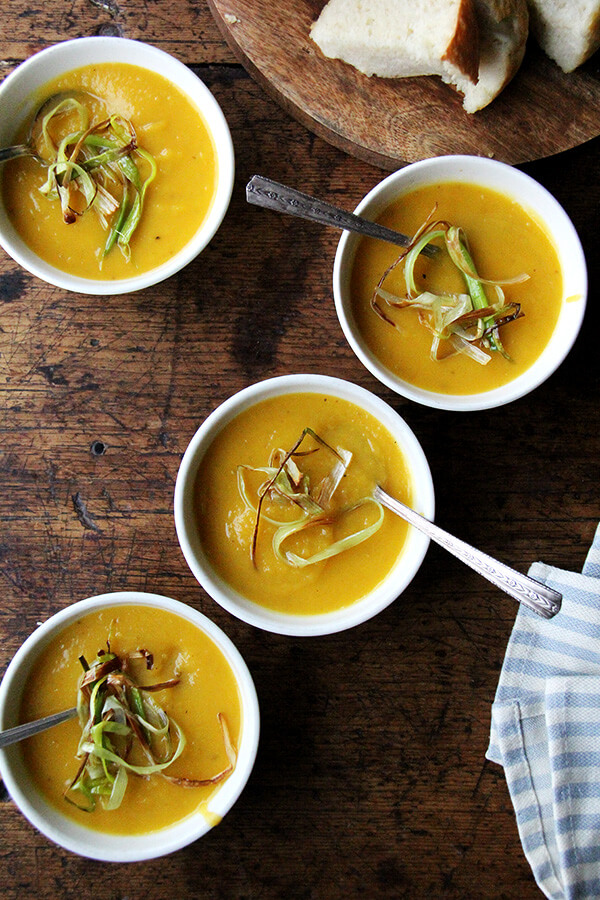 Slow cooker butternut squash soup with apple and coconut milk in bowls.