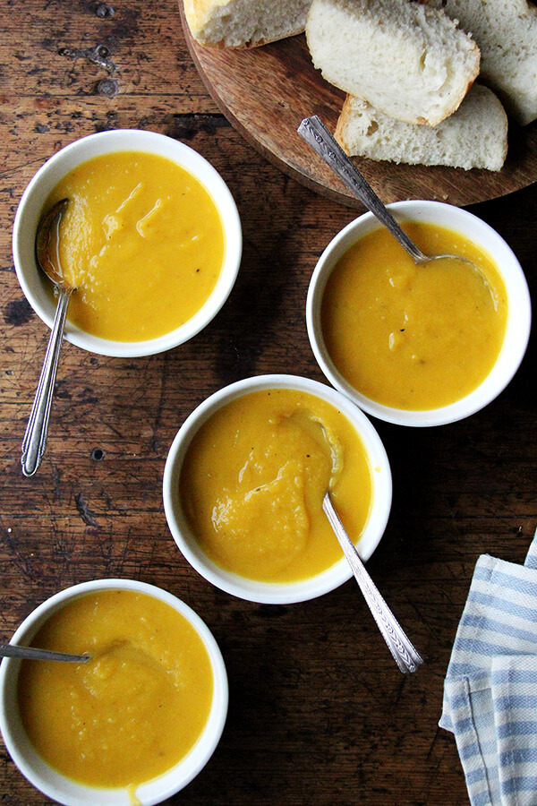 Bowls of butternut squash and apple soup.
