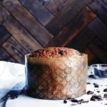 Baked chocolate-studded panettone bread recipe wrapped in large paper mould.