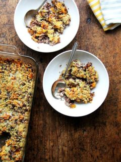 Two bowls of roasted butternut squash and onion quinoa bake.