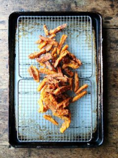 A tray of just fried thick-cut sweet potato fries.