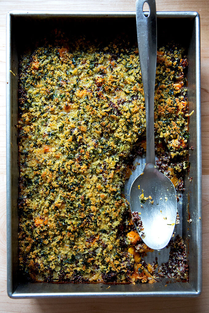 A 9x13-inch pan of just-baked quinoa bake with roasted butternut squash and onions.