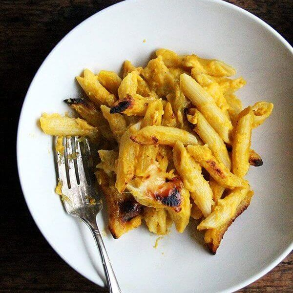 A bowl of baked penne with butternut sage sauce.