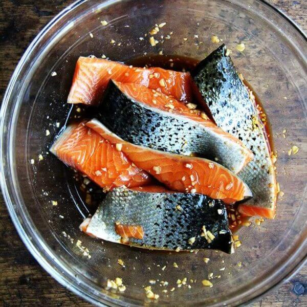 A bowl of ginger-soy marinating salmon.