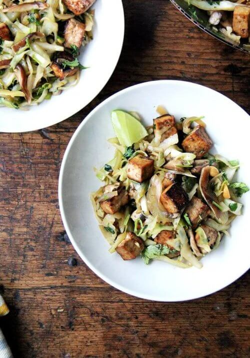 In this cabbage pad thai, sugar and lime juice in the stir-fry sauce stand in for tamarind, whose fruity, tart flavor lends that sweet-and-sourness characteristic of traditional pad Thai. This dish comes together quickly, and while the vegetables and seasonings may be unorthodox, the combination is tasty and satisfying. // alexandracooks.com
