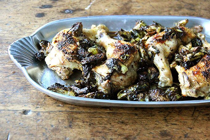 A platter of sheet pan chicken and Brussels sprouts.