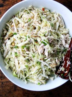 A large bowl of chicken and cabbage salad.