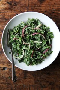 In this kale Cesar salad, the dressing is light and lemony and the kale itself is extremelysoft and tender. It's also vegan, the dressing made with vegannaise and vegan Worcestershire. The combination of curly kale, massaged till tender, quick-pickled onions, and toasted pumpkin seeds, which add so much texture and flavor, is so good. I think this is one you have to taste to believe. // alexandracooks.com