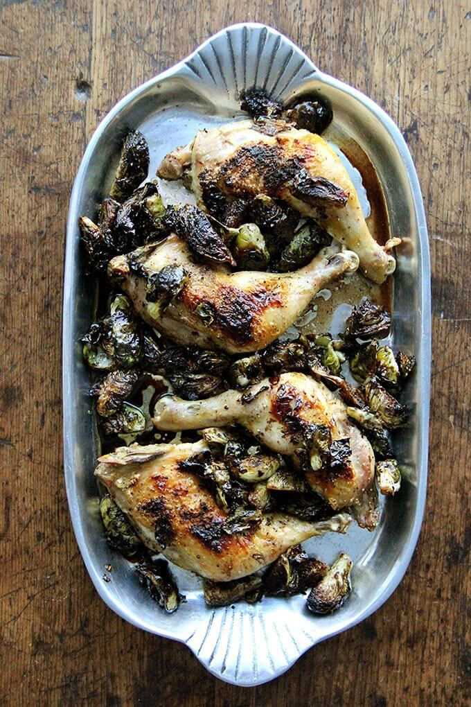 In this roast chicken with Brussels sprouts recipe, after roasting chicken legs, the emptied pan gets hit with a few tablespoons of syrupy balsamic vinegar, which not only deglazes it, but also provides that bite so often welcomed by the cabbage family of vegetables. // alexandracooks.com