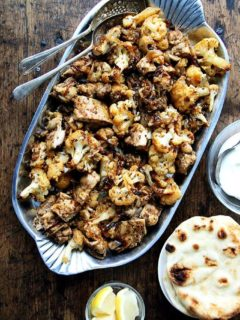 A platter of sheet pan chicken and cauliflower shawarma.