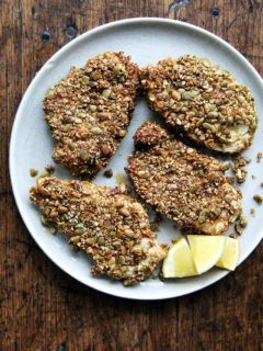 "Here's the gist of these pepita-crusted chicken cutlets: toast pumpkin seeds, crush them coarsely, mix with a few spices (smoked paprika or ancho chile powder, cumin and cayenne), then use them to ""bread"" your cutlets. If you love panko chicken and are looking for a little change, give this one a go—the seeds add such a lovely texture and flavor. // alexandracooks.com"
