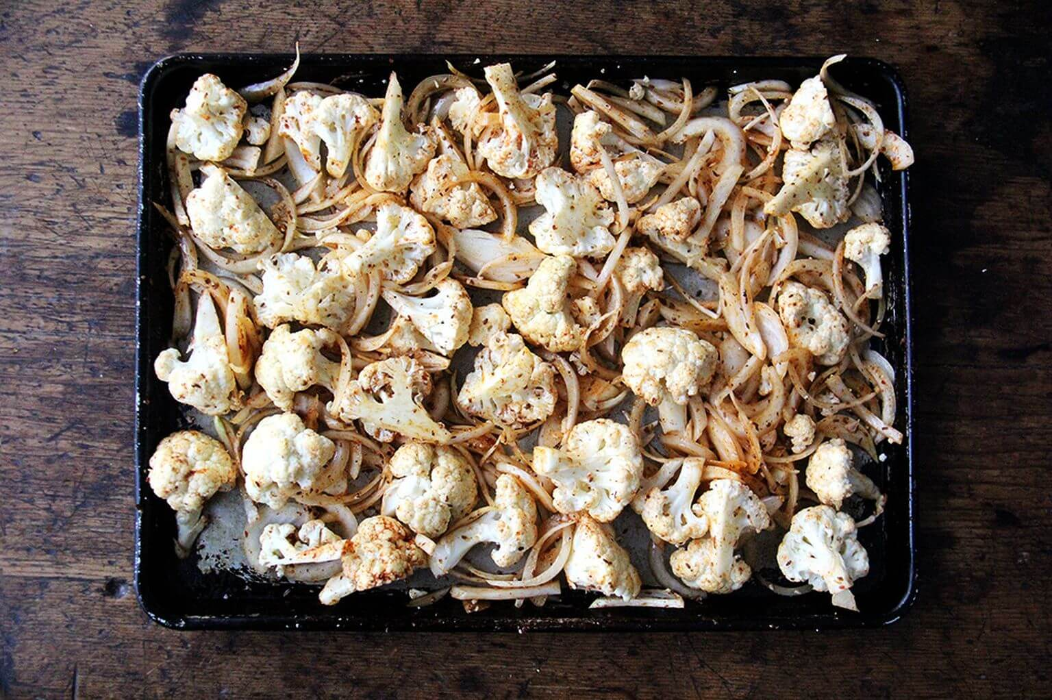 A sheet pan of cauliflower and onions with shawarma spices.