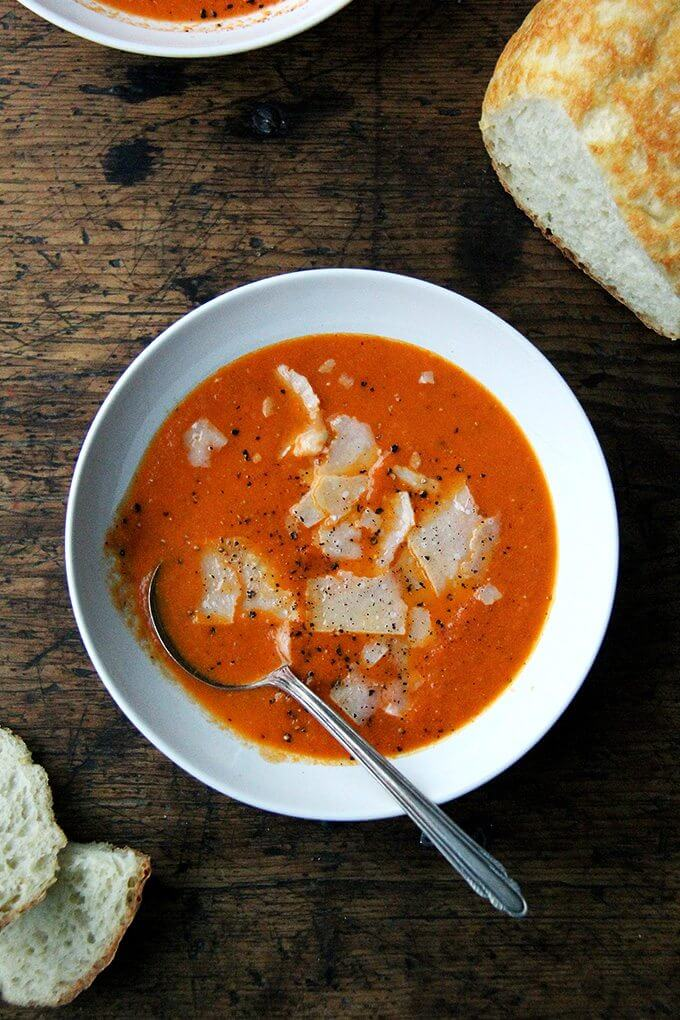 This recipe for tomato soup is incredibly simple, calling for nearly all pantry items: onions, garlic, tomato paste, and canned peeled tomatoes. I like to serve the soup with lots of freshly cracked pepper and shaved parmesan and bread, of course. // alexandracooks.com