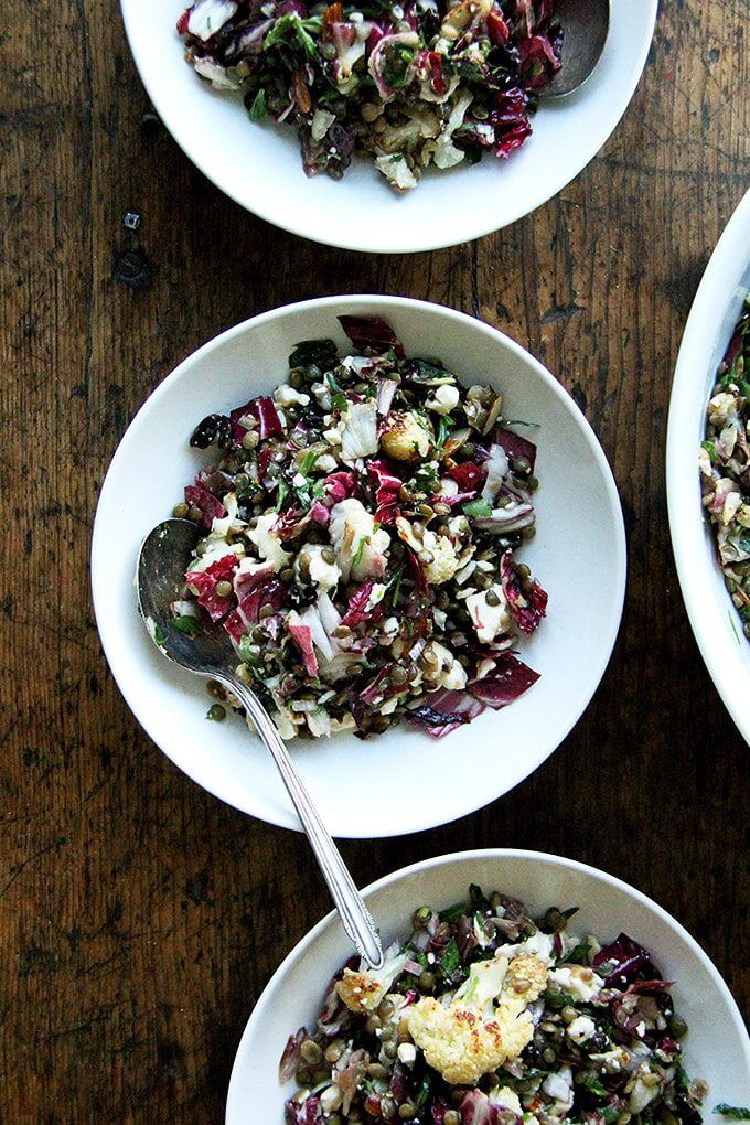 This salad is a combination of roasted vegetables, lentils, walnuts, and goat cheese. But there's a lot more to it than what's revealed in the title. There's raw radicchio, lots of fresh tarragon, and it's all dressed in an at once sharp, sweet, and salty dressing made with minced anchovies, shallots, mustard, honey, and currants. The whole combination is just so good. // alexandracooks.com