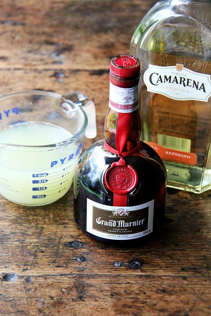 Margarita ingredients: fresh lime juice, grand marnier, tequila.