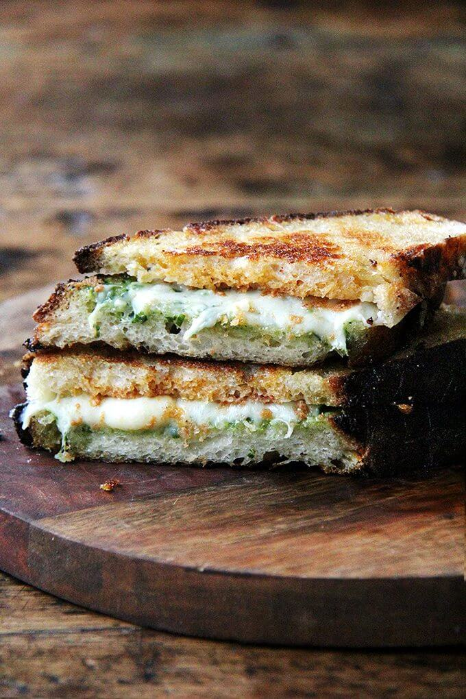 This 'nduja grilled cheese includes Wisconsin fontina, a great melting cheese, and basil pesto, to offer a fresh counterpoint to the richness of the pâte-like spread. In keeping with the Italian theme, I sandwiched the three ingredients between thick slices of ciabatta, whose porous crumb so nicely absorbed the flavors of the spicy 'nduja and sweet, earthy fontina. Yum. // alexandracooks.com