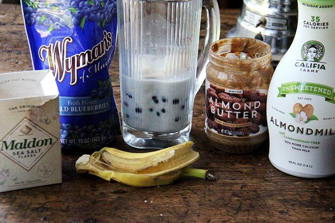 Ingredients to make blueberry-almond smoothie.