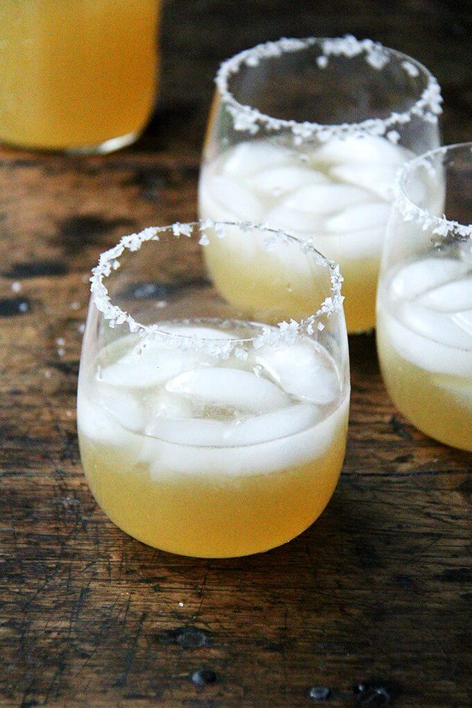 Margaritas in salted-rim glasses.