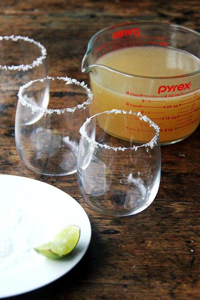 Salted margarita glasses on a table.