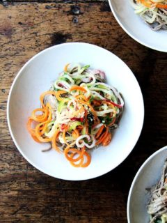 This recipe for almond-sesame soba noodles with quick-pickled vegetables is really fun and super easy. It's also a good one to rely on in the summer — it's so refreshing — and, if you subscribe to a CSA or tend a prolific garden, it makes great use of all of those carrots, cucumbers, and radishes you may find yourself up to your eyeballs in. // alexandracooks.com