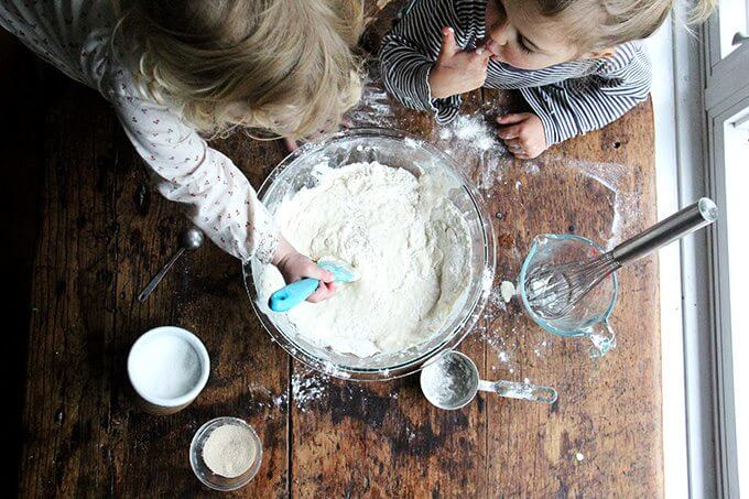 Overhead shot of kids making pizza dough.