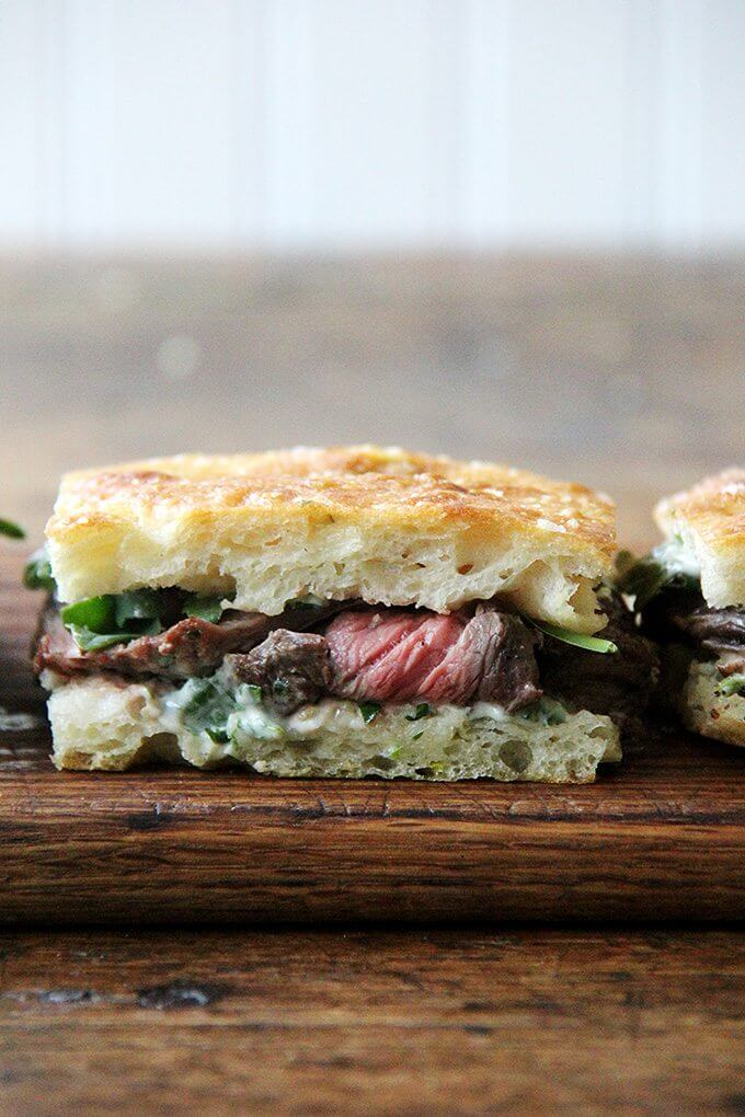 In these skirt steak sandwiches, skirt steak, which cooks to medium-rare in just about 5 minutes, is layered with arugula between slices of focaccia smeared with herbed mayonnaise. The key, as with all meats, is to let the steak rest for at least 10 minutes before slicing, and with skirt steak, to slice it thinly against the grain. // alexandracooks.com