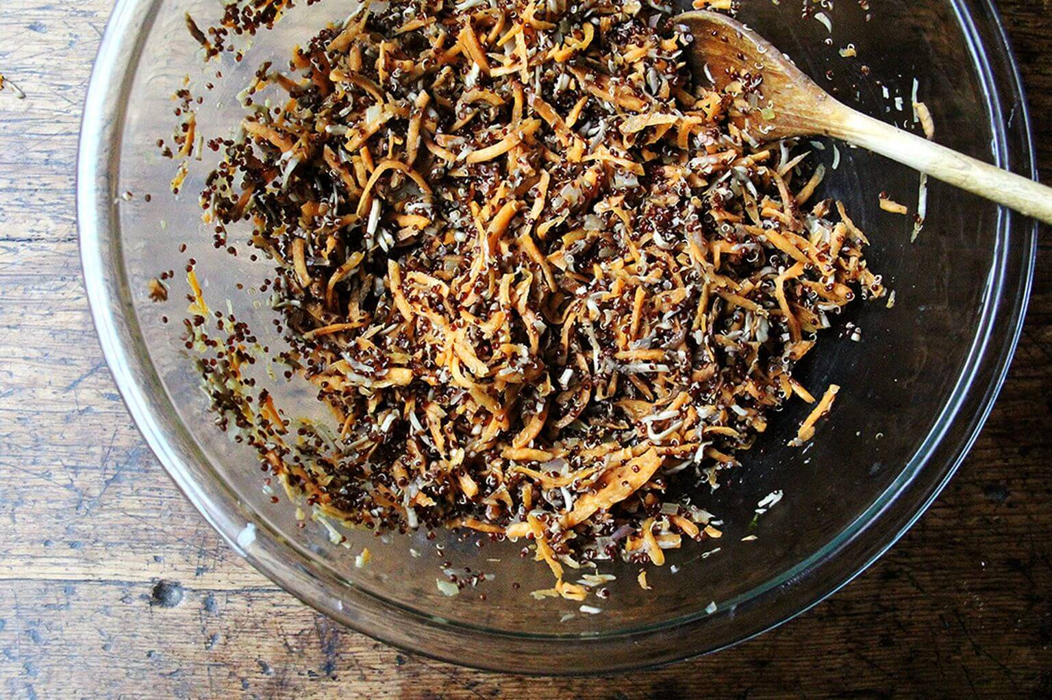 A bowl of grated sweet potatoes and mushrooms for veggie burgers.