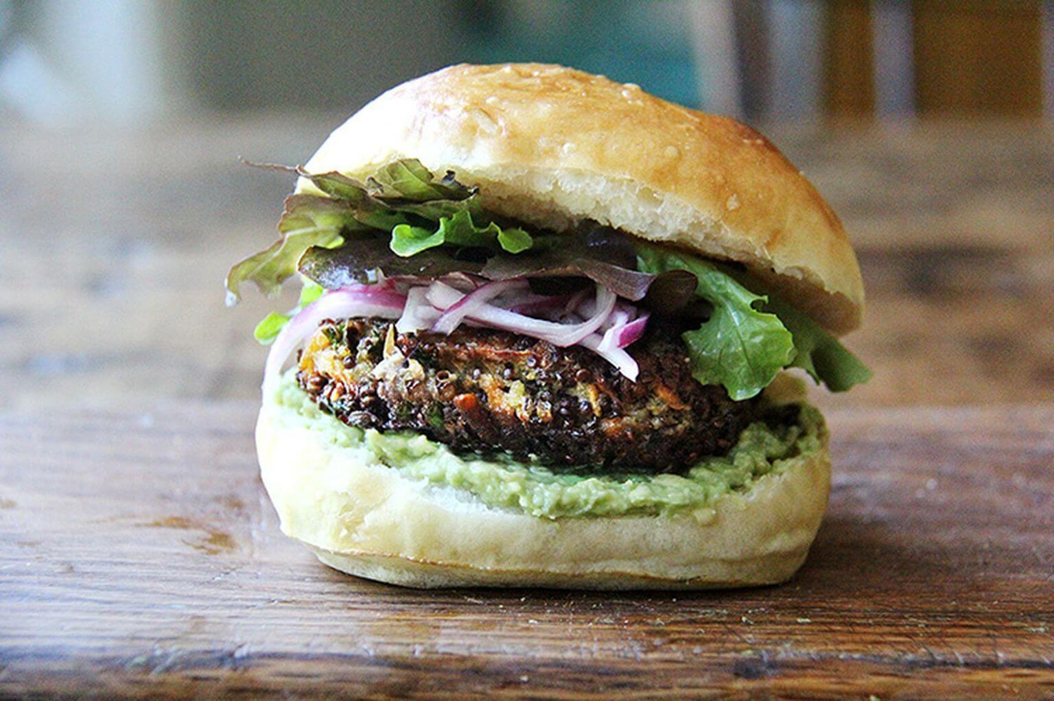 A mushroom-quinoa veggie burger on a board.