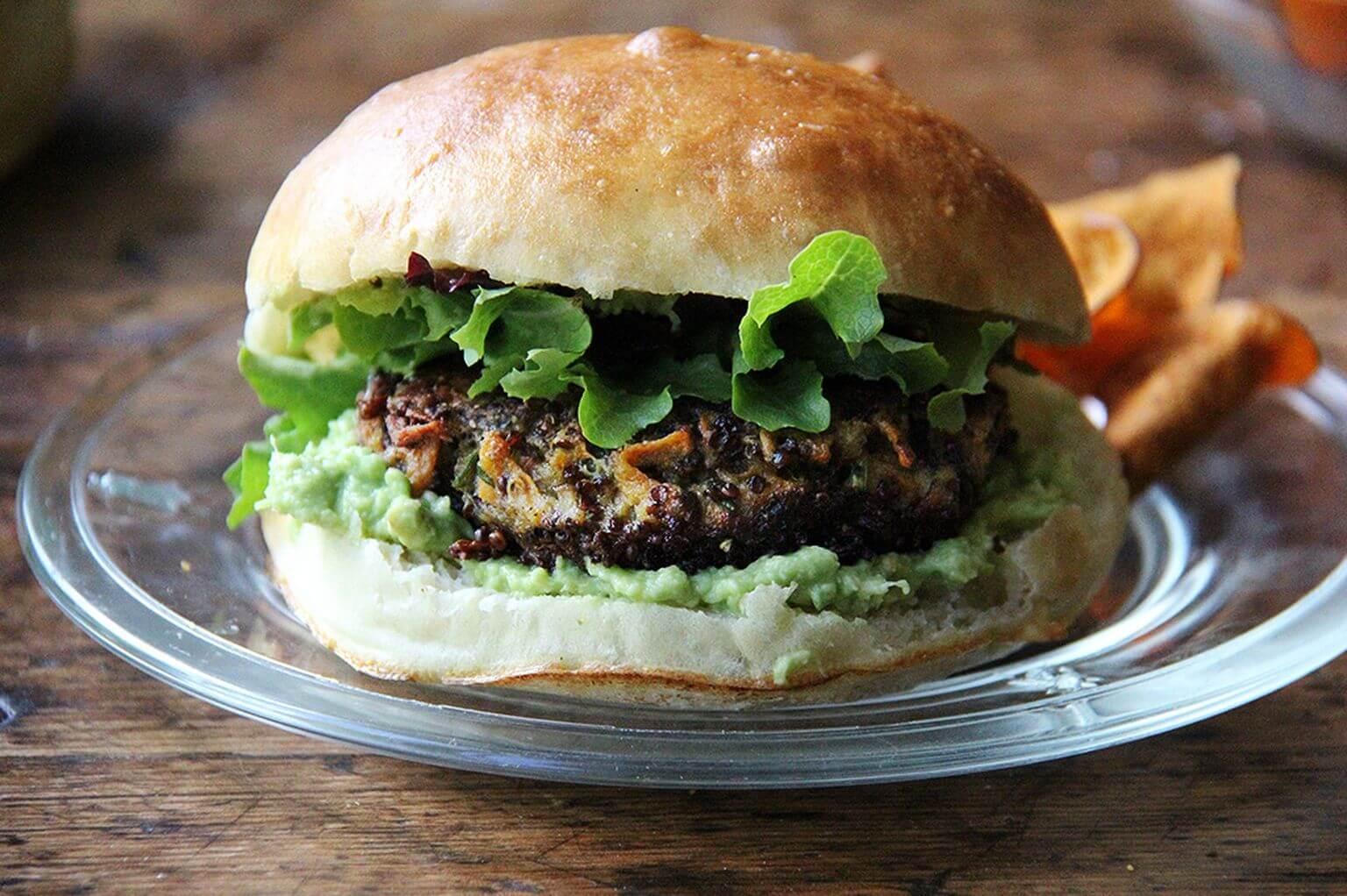 A mushroom-quinoa veggie burger on a plate.