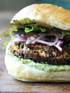 A sweet potato and mushroom quinoa burger on a plate.