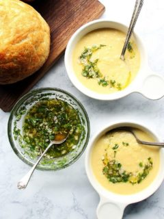 Overhead shot of corn soup with herb salsa.
