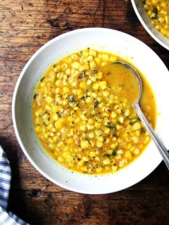 A bowl of curried corn soup.